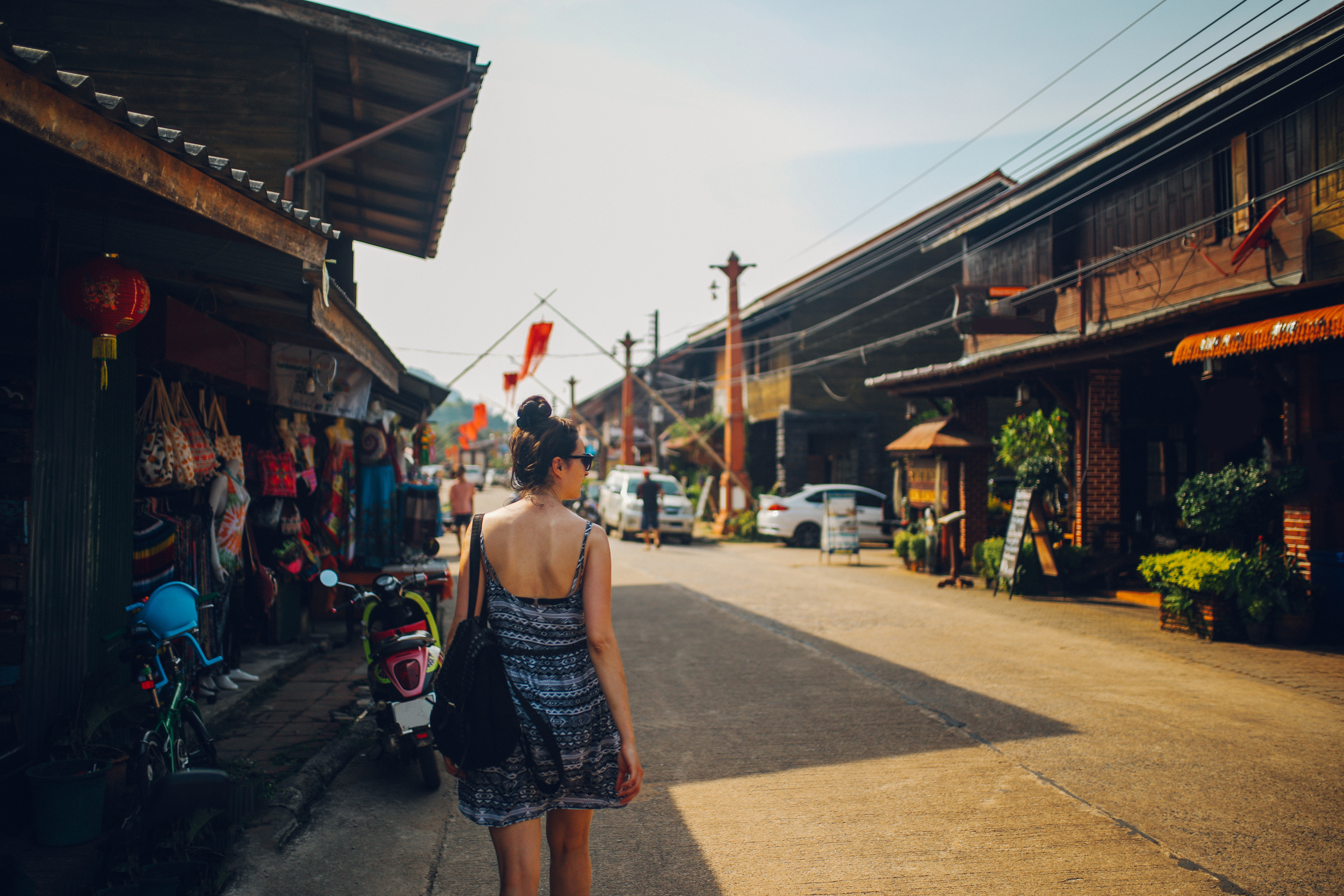 Young woman walking in the Old Town of the Koh Lanta island, Thailand